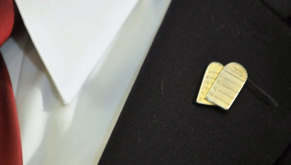 Roy Moore sported a Ten Commandments pin on June 1,