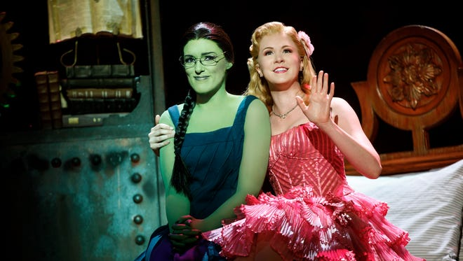 """Mary Kate Morrissey as Elphaba and Ginna Claire Mason as Glinda in the Broadway touring production of """"Wicked."""""""