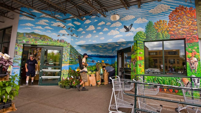 City Market in Burlington, seen on Tuesday, July 26, 2016, is seeking artists to paint murals on its new South End location — which is scheduled to open in summer 2017. The mural here at the downtown co-op's entrance was painted by Tara Goreau.