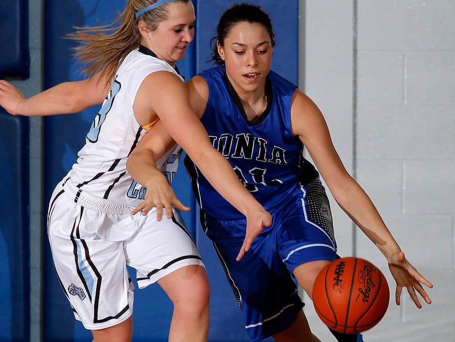 Ionia's Jaylynn Williams, right, drives against pressure from Lansing Catholic's Lauren Rule Friday, Jan. 9, 2015, in Lansing, Mich.