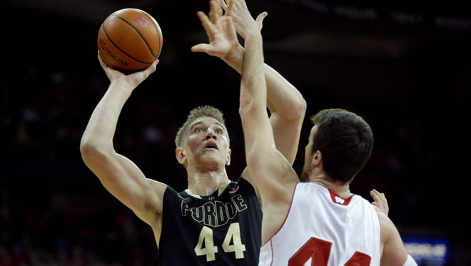 MADISON, WI - JANUARY 07:  Isaac Haas #44 of the Purdue Boilermakers drives to the hoop during the first half against Wisconsin Badgers at Kohl Center on January 07, 2015 in Madison, Wisconsin. (Photo by Mike McGinnis/Getty Images)