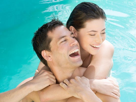 Couple embracing in a pool