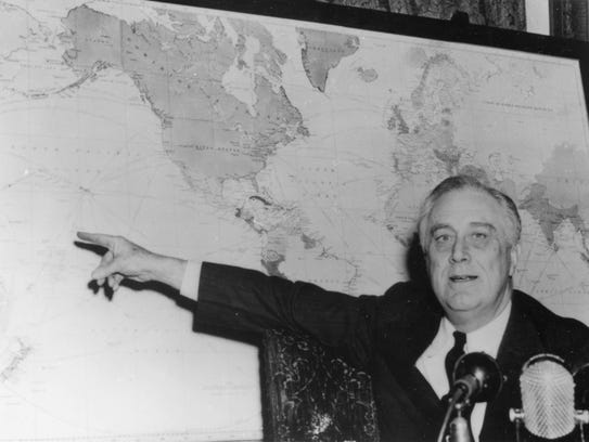 President Franklin Roosevelt pointing to Guadalcanal,