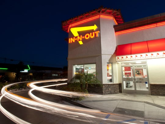 In this June 8, 2010 photo, cars exit the drive-thru at In-N-Out Burger in Baldwin Park.