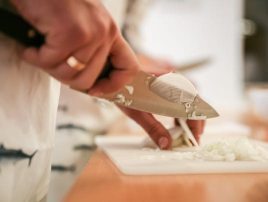 Cooking Classes  Instructor Teaches How Cutting onion