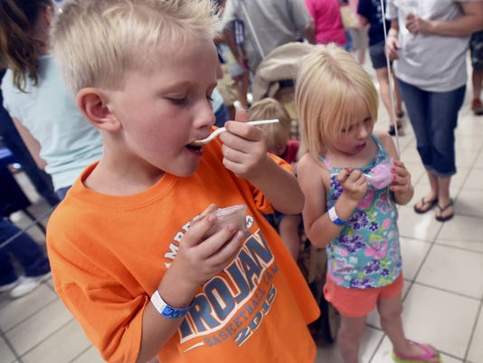 Braden Lehman, 7, and Rachel Lehman, 5, of Chambersburg taste different flavors of ice cream Saturday during Scoop-A-Palooza at Chambersburg High School.