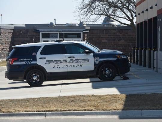 A police vehicle is parked outside the St. Joseph Government