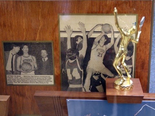 Newspaper clippings of All-time boys basketball scoring leader Artie Flaherty Sr. (Bulldog Spirit, Class of 1985) are displayed in one of the trophy cases.