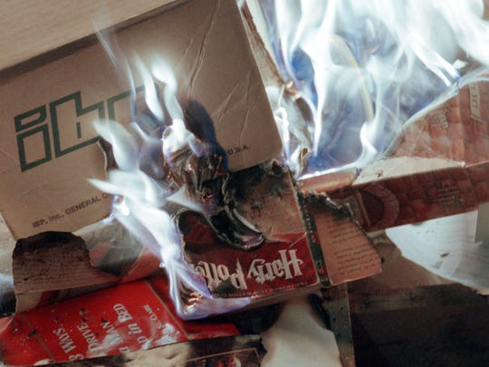 A copy of a Harry Potter book burns in a bonfire during a protest outside the Christ Community Church in 2001 in Alamogordo, New Mexico.