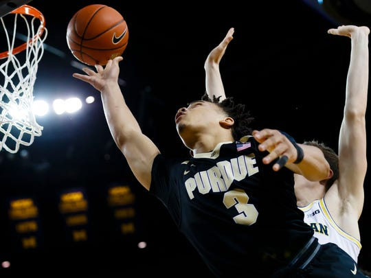 Boilermakers guard Carsen Edwards (3) goes to the basket defended by Michigan Wolverines guard Duncan Robinson (22) in the second half at Crisler Center.