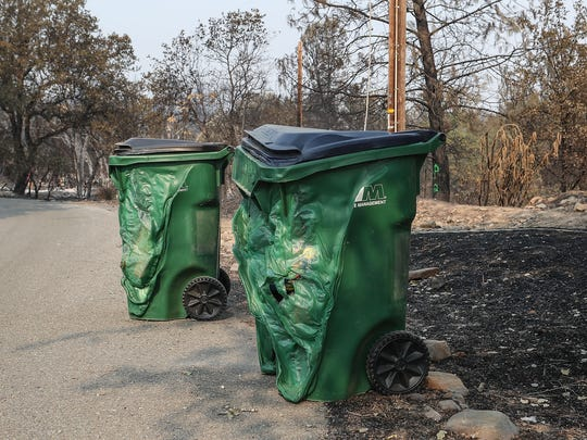 Trash can were melted by the heat from the Carr Fire on Middle Creek Rd in Redding, August 3, 2018