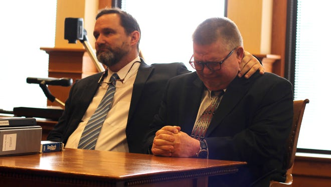 Matthew Cornett Jr., right, on trial for rape and abduction, reacts to being found not guilty on all counts Thursday. His defense attorney, Troy Wisehart, is at left.