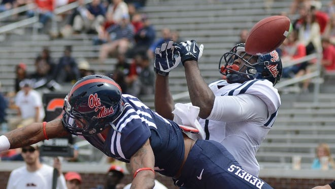 Ole Miss receiver Laquon Treadwell, right, is unable to haul in a pass in the endzone as defensive back Derrick Jones defends during Saturday's Grove Bowl in Oxford.