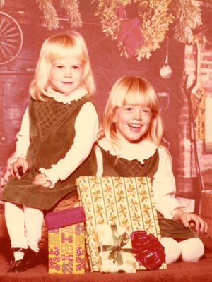 Sara and younger sister Amy, left, can't wait to open these fake presents back in the early 1980s.