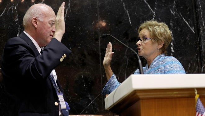 Indiana's Secretary of State Connie Lawson is sworn in as president of the National Association of Secretaries of State by William Gardner, New Hampshire Secretary of State, at the Indiana Statehouse Monday, June 10, 2017.
