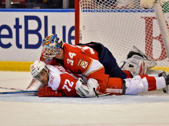 Red Wings left wing Andreas Athanasiou collides with Panthers goalie James Reimer during the first period of the Wings' 3-2 shoot-out win Saturday, Oct. 28, 2017, in Sunrise, Fla.