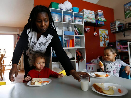 Tonja Boggs serves up milk and snacks to her day care