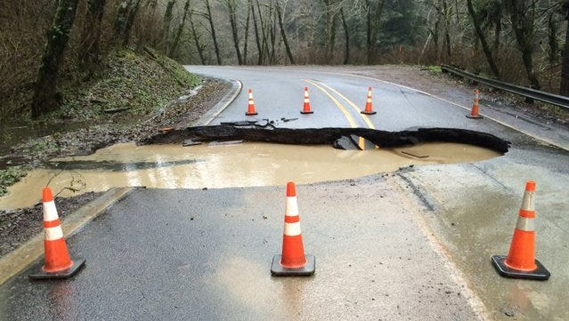 A sinkhole opened under a section of Highway 22 northwest of Grand Ronde.