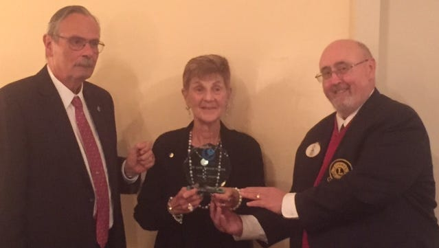 The Bridgeton Lions Club celebrated its 75th Charter Night Anniversary Dinner on Oct. 1 at the Centerton Country Club and Event Center in Pittsgrove. During the event, Lion Bill Souser (left) and District 16L Governor Robert Freiel presented Lion Karen Shapiro the PID Gene Polgar Fellow Award.