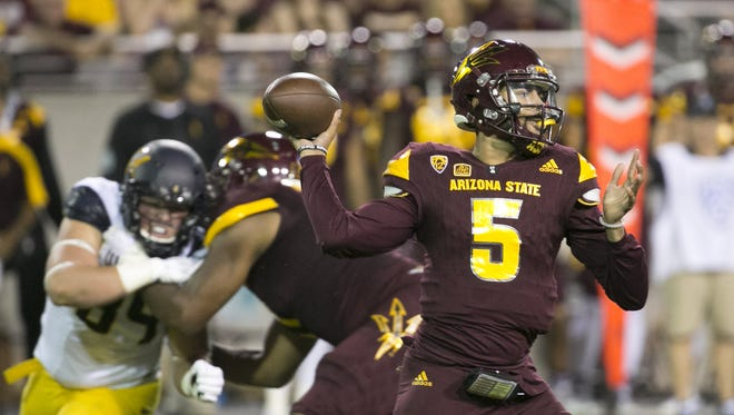 ASU quarterback Manny Wilkins passes against Cal during the first quarter of the college football game at Sun Devil Stadium in Tempe on Saturday, September 24, 2016.