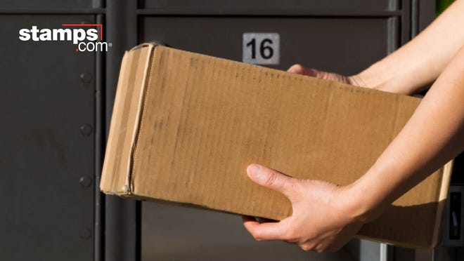 Two arms holding a box in front of a row of large post office boxes, with Stamps.com logo in the corner.