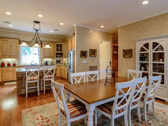 The kitchen has granite and stainless-steel appliances.