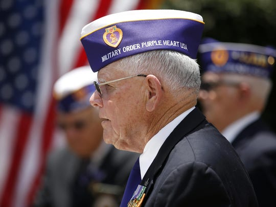 Major John L. Haynes of the Military Order of Purple Hearts gives a speech at the Capitol during a rededication of the Purple Heart Memorial Friday, Aug. 7, 2015.