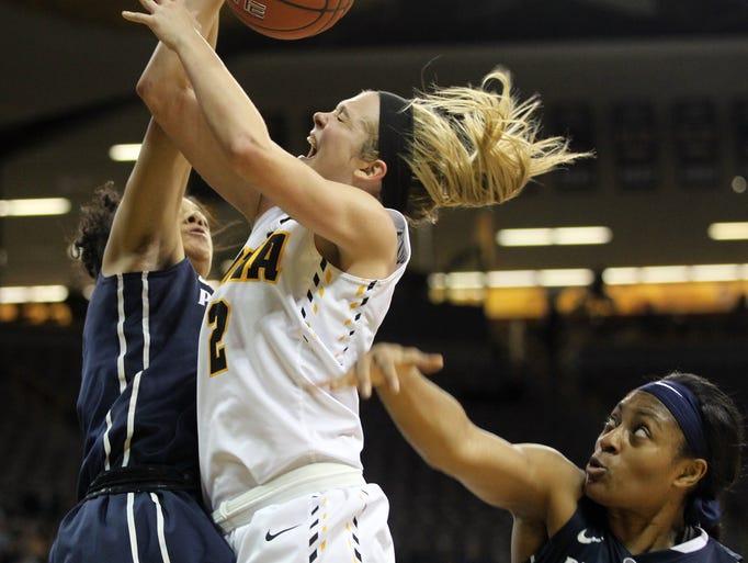 Iowa's Ally Disterhoft draws a foul during the Hawkeyes'