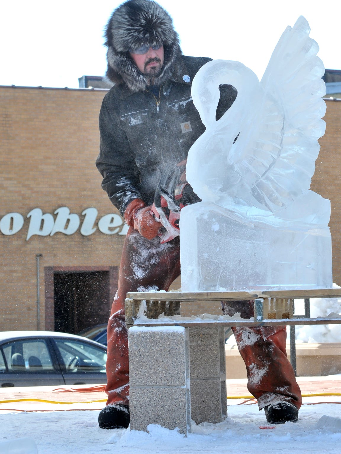 In this 2012 file photo, Steve Brandt of Cedarburg carves a swan sculpture out of a ice block during Winter Fest 2012 at The 400 Block in downtown Wausau.