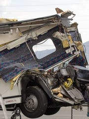 This photo shows the USA Holiday tour bus that was destroyed after colliding with a big rig on Oct. 23, 2016. Thirteen people died in the collision and 30 others were injured.