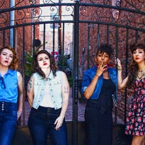 Staff members of Love Your Rebellion and members of the feminist organization of the same name: (left to right) Michelle Carraway, Angela Page, Maegan Trice and Carmen Guerrero.