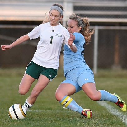 Indian River's Sarah Buchler and Cape Henlopen's Cassandra Garcia fight for the ball. Buchler has moved to the midfield for the upcoming season as the Indians defend their Henlopen crown.