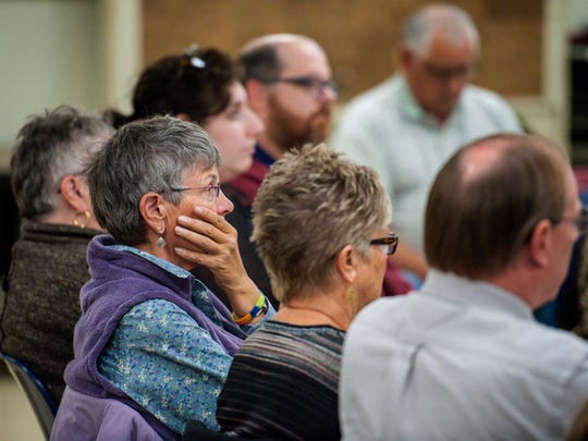 Residents listen as South Burlington's Director of Planning and Zoning Paul Conner, not pictured, speaks during a meeting to discuss the Burlington International Airport's proposed buyouts of neighboring houses in South Burlington on Wednesday, October 12, 2016.