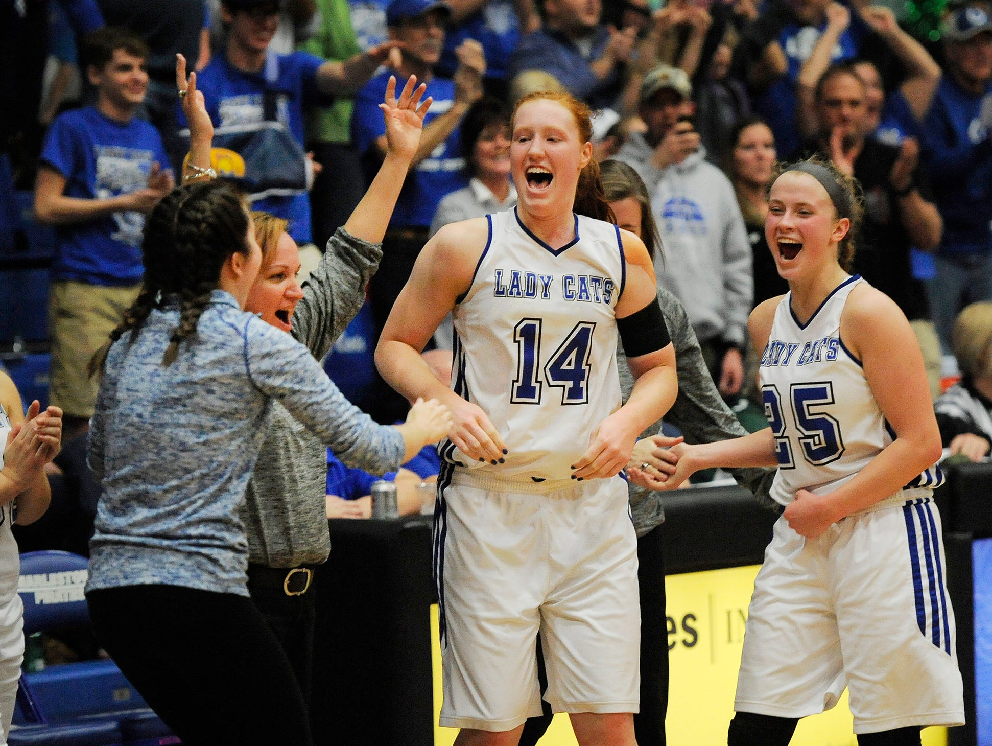 North Harrison head coach Missy Voyles (second from left) celebrates with Lilly Hatton (14) and Cali Nolot (25) after defeating Vincennes-Lincoln 61-48 on Saturday during the 3A Regional Final game at Charlestown High School. (Photo by David Lee Hartlage, Special to The Courier-Journal) Feb. 11, 2017