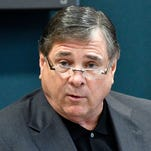 Louisville settles for $4.5 M with ex-AD Jurich over firing