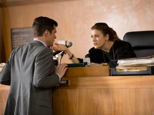 "John Ducey and Kate Walsh appear in a scene from ""Bad Judge,"" premiering Oct. 2."