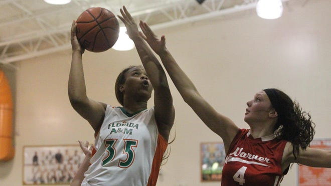 FAMU DRS senior Dominique Jeffery drives for a basket during a 75-21 win over Warner Christian in a FHSAA Class 3A semifinal.