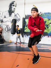 Antwoine Dorm Jr., 11, of York City, works out at