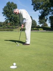 Bob Elser, of Spring Garden Township, watches his putt