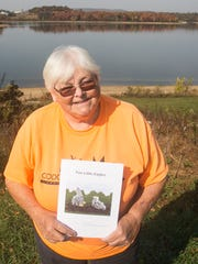 "Codorus State Park volunteer Karen Lippy, of Hanover, poses for a photo with her latest book, titled ""Two Little Eagles,"" Wednesday, Nov. 2, 2016, near the Marina Classroom at the park. This is Lippy's third self-published book. Two others are in the works.  Amanda J. Cain photo"