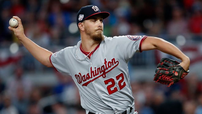 Washington Nationals starting pitcher A.J. Cole works in the first inning of the team's baseball game against the Atlanta Braves on Tuesday, April 3, 2018, in Atlanta. (AP Photo/John Bazemore)