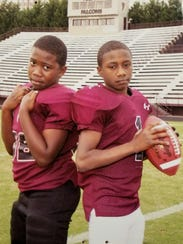 Brothers Zaevion and Zack Dobson pose for a photo on the Fulton High School football field while the two were in elementary school. Zack is attending Middle Tennessee State University this fall on an athletic scholarship.