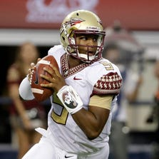 Florida State quarterback Jameis Winston rolls out of the pocket during the Oklahoma State game on Saturday in Arlington, Texas.