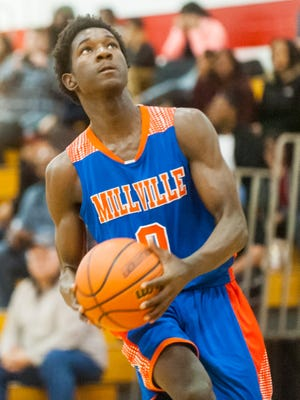 Millville guard Rynell Lawrence (0) goes up for a lay up against Vineland at Vineland High School on Wednesday, December 21.