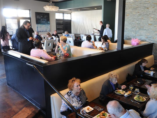 Noah Skultety, left, co-owner of Twenty88, assists customers at the Camarillo eatery.