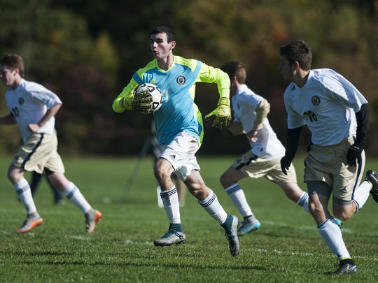 Essex goalie Paul Federico (1) runs with the ball after making a save during a high school boys soccer game Saturday.
