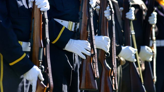 Members of the Mason VFW and Mason American Legion firing squad at the Mason Veterans Memorial.