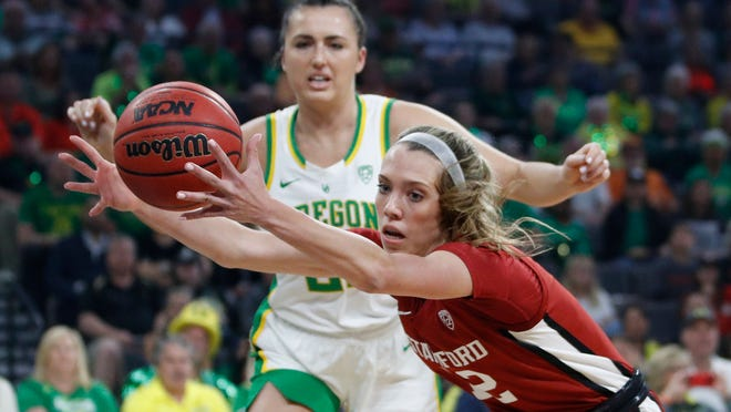 Stanford's Lexie Hull, right, grabs a rebound in front of Oregon's Erin Boley during the Pac-12 Tournament championship game on March 8 in Las Vegas.
