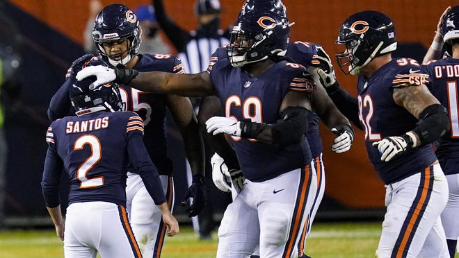 Chicago Bears kicker Cairo Santos (2) is congregated by teammates after game-winning field goal against the Tampa Bay Buccaneers in the second half of an NFL football game in Chicago, Thursday, Oct. 8, 2020. The Bears defeated the Buccaneers 20-19.
