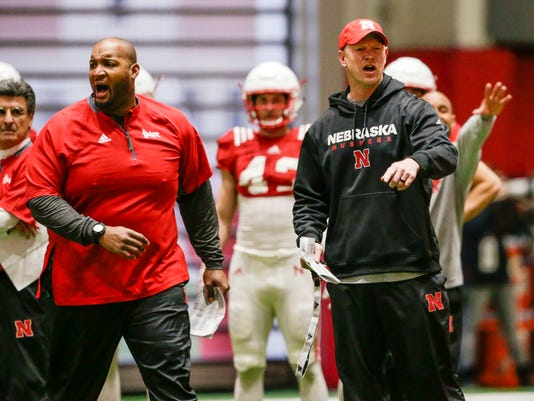 In this April 3, 2018, photo, Nebraska head coach Scott Frost, right, and offensive line coach Greg Austin, left, shout instructions during spring training in Lincoln, Neb. Unlike the trend in the sport of less contact in practices instead of more, coach Frost wants Huskers' practices to be physical to toughen up his team. (AP Photo/Nati Harnik)